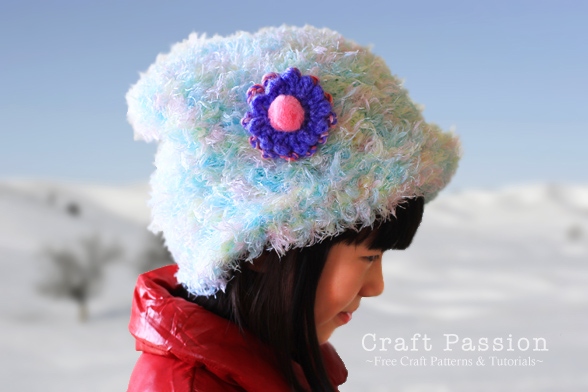 beanie hat with simple crochet flower brooch