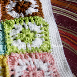 Single crochet on the bottom hem of granny square top