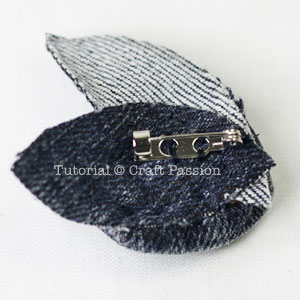 back of denim rosette brooch
