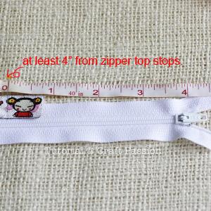 sew ribbon and zipper into purse