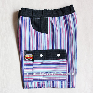 cargo pocket with prong snap button
