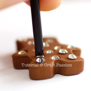 push rhinestone into polymer clay